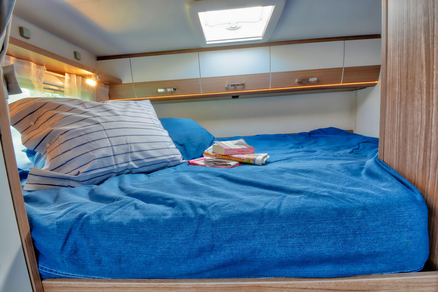 SkandiTrip family luxury motorhome doublebed in the back of the vehicle