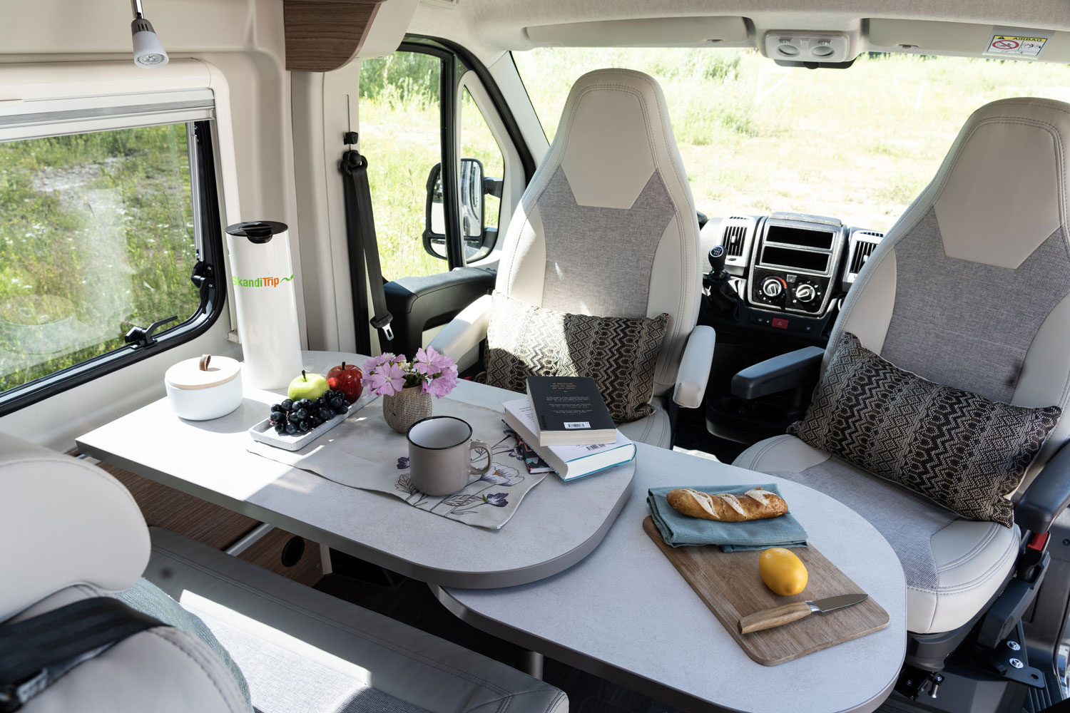 SkandiTrip petit camping car entrance and living room seats